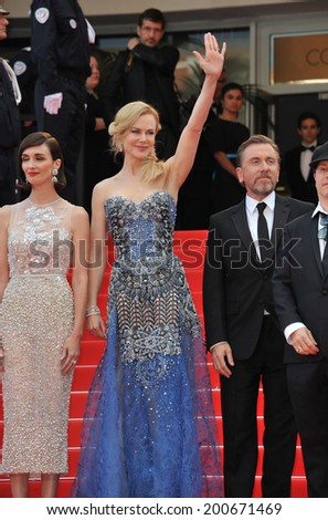 "CANNES, FRANCE - MAY 14, 2014: Nicole Kidman, Paz Vega (left) & Tim Roth at the gala premiere of their movie ""Grace of Monaco"" at the 67th Festival de Cannes.  - stock photo"