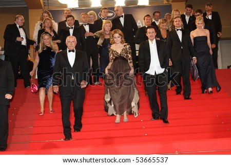 CANNES, FRANCE - MAY 22: Oleg Menshikov, Nadezhda  and Nikita Mikhalkov depart the premiere of 'The Exodus ' Premiere at the Palais  during the 63rd  Cannes  Festival on May 22, 2010 in Cannes, France - stock photo