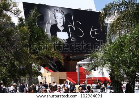 CANNES, FRANCE - MAY 16: Palais des Festivals facade shown and  the official poster 65th Annual Cannes Film Festival at Palais des Festivals on May 16, 2012 in Cannes, France. - stock photo