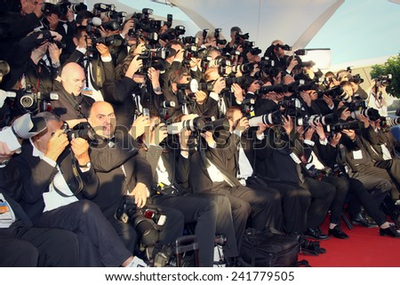 CANNES, FRANCE - MAY 24: Photographers attend the Closing Ceremony and 'A Fistful of Dollars' Screening during the 67th Annual Cannes Film Festival on May 24, 2014 in Cannes, France. - stock photo