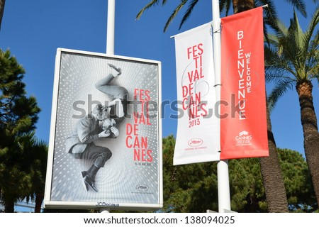 CANNES, FRANCE - MAY 11: Poster advertising shown on May 11, 2013 in Cannes,France. Official poster for the international movie festival 2013 presented on the famous Boulevard Croisette in Cannes. - stock photo