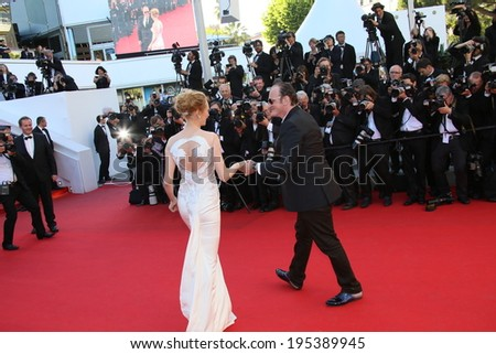 CANNES, FRANCE - MAY 24: Quentin Tarantino and Uma Thurman attend the Closing Ceremony and 'A Fistful of Dollars' Screening during the 67th Cannes Film Festival on May 24, 2014 in Cannes, France. - stock photo