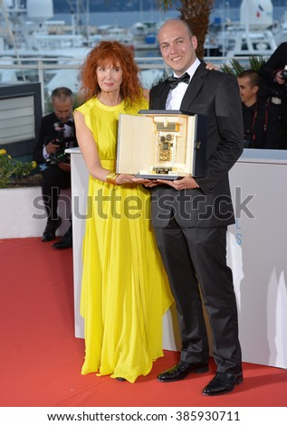 CANNES, FRANCE - MAY 24, 2015: Sabine Azema & Colombian director Cesar Augusto Acevedo - winner of the Camera d'Or Award - at the winners' photocall at the 68th Festival de Cannes. - stock photo
