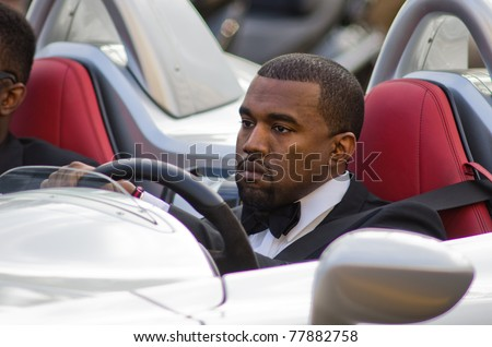 CANNES, FRANCE - MAY 19: singer kayne west drive a fast car on the croisette during the 64th Annual Cannes Film Festival on May 19, 2011 in Cannes, France. - stock photo