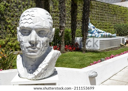 CANNES, FRANCE - MAY 14, 2014: Tadashii, sculpture made of marble by Italian artist Rabarama, alias Paola Epifani, at the exposition in front of the Gallery Cannes Croisette - stock photo