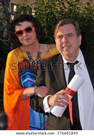 CANNES, FRANCE - MAY 24, 2014: Timothy Spall, winner of Best Actor Award for Mr. Turner, & wife Shane at the awards photocall at the 67th Festival de Cannes. - stock photo