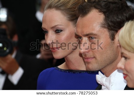 CANNES, FRANCE - MAY 22: Uma Thurman, Jude Law attend the 'Les Bien-Aimes' premiere  during the 64th Cannes Film Festival at Palais des Festivals on May 22, 2011 in Cannes, France. - stock photo