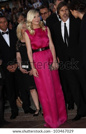 CANNES, FRANCE - MAY 23: Walter Salles, Kirsten Dunst attend the 'On The Road' Premiere during the 65th Cannes Film Festival at Palais des Festivals on May 23, 2012 in Cannes, France. - stock photo