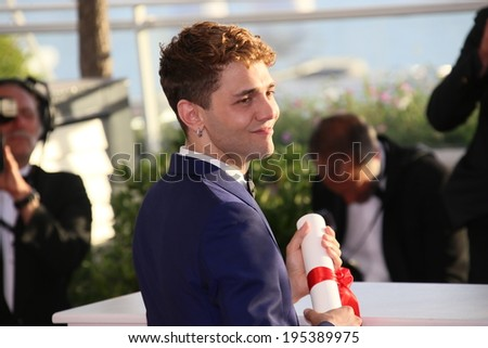 CANNES, FRANCE - MAY 24: Xavier Dolan winner of the Best Director award, attends the Palme D'Or Winners photocall during the 67th Cannes Film Festival on May 24, 2014 in Cannes, France. - stock photo