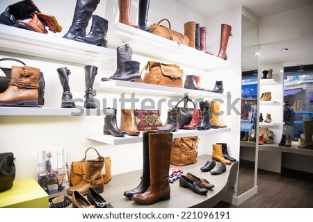 CANNES, FRANCE- OCTOBER 1, 2012: Bags and shoes in the clothing store - stock photo