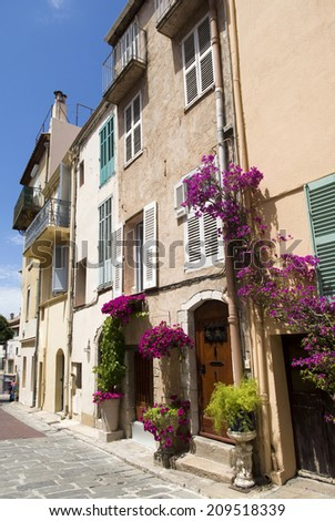 Cannes, French Riviera. Colourful facade the houses  - stock photo