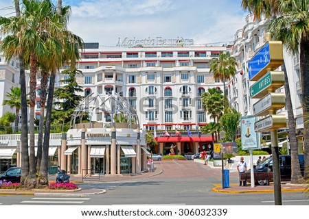 CANNES - JUNE 2, 2015: The luxury Hotel Majestic Barriere in Cannes at Boulevard de la Croisette. Cannes, French Riviera. The city is busy tourist destination and host of annual Cannes Film Festival. - stock photo