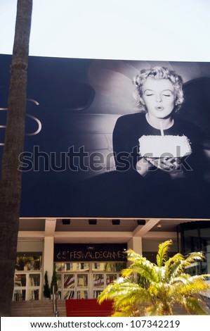CANNES-MAY 15:  Otto Beckmann's iconic photo of Marilyn Monroe blowing out birthday cake candles at Cannes Film Festival in Cannes, France on May 15, 2012. - stock photo