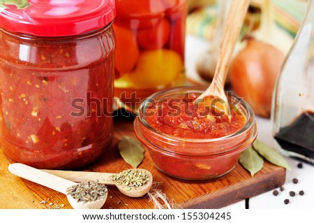 Canning Marinara sauce, tomato preserves - stock photo
