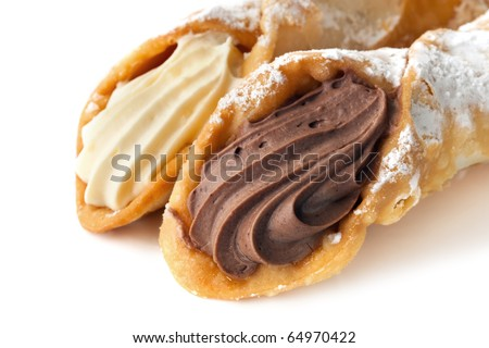 Cannoli pastries.  Traditional Italian dessert, filled with a rich vanilla and chocolate cream. - stock photo