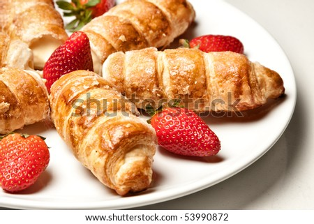 cannoli with strawberries on a white background