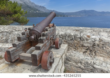 Cannon at medieval fortress in Korcula town, Korcula, Croatia  - stock photo