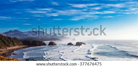 Cannon Beach and Haystack Rock in Northwest Oregon  - stock photo