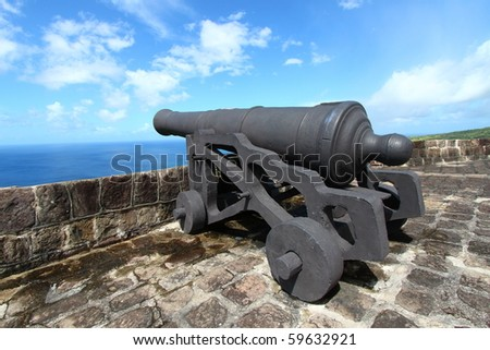 Cannon faces the Caribbean Sea at Brimstone Hill Fortress in Saint Kitts - stock photo