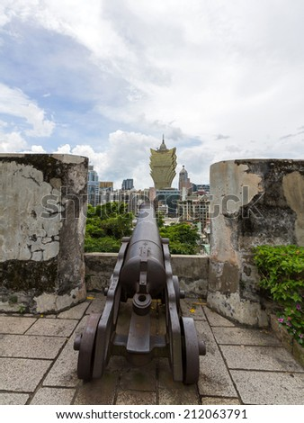 Cannon guarding the battlements of ancient Monte Fort in Macau, China  - stock photo