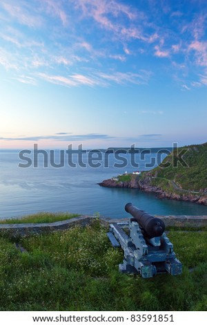 Cannon looking over the entrance to St. John's Harbor, Newfoundland. - stock photo