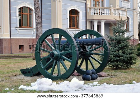 Cannon on background of palace. - stock photo