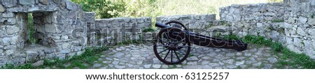 cannon on the castle wall - stock photo