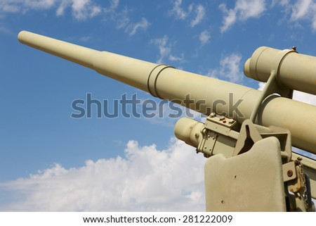 Cannon war in green tone with blue sky background. Horizontal