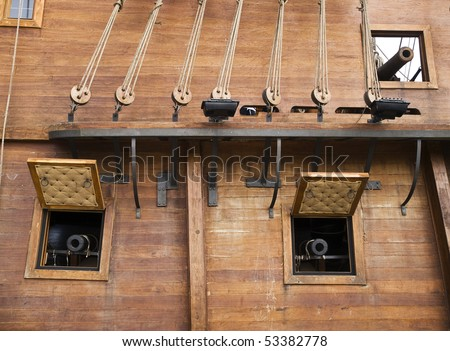 Cannon windows on a 17th Century Spanish Armada galleon berthed at the Grand Harbour in Malta
