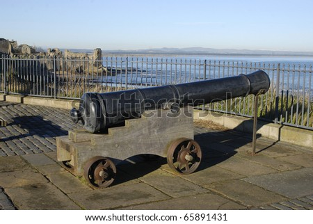 Cannon with medieval Castle ruins in background, St.Andrews, Fife, Scotland - stock photo