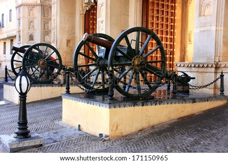 Cannons at City Palace complex gate, Udaipur, Rajasthan, India - stock photo