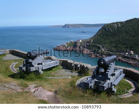 Cannons defending entrance to St. John's Harbour.  Newfoundland.  Canada. - stock photo