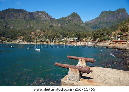 Cannons on the jetty of San Juan Bautista on Robinson Crusoe Island, one of three main islands making up the Juan Fernandez Islands some 400 miles off the coast of Chile - stock photo
