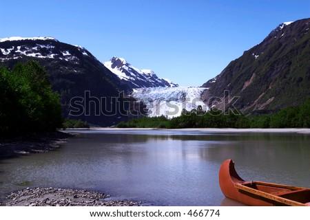Canoe at Davidson Glacier, Alaska. - stock photo