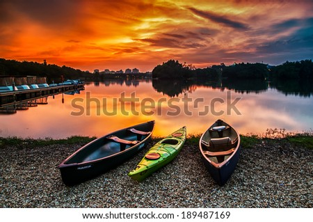 Canoe at wetland Putrajaya during sunset - stock photo