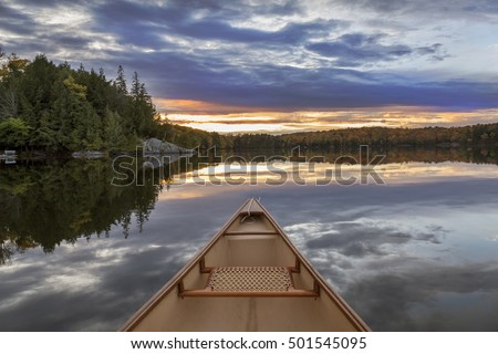 Canoe bow at sunset on an autumn lake in Ontario, Canada