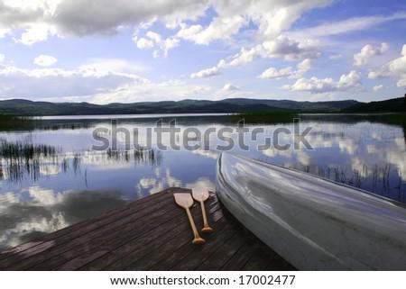 Canoe by a lake - stock photo