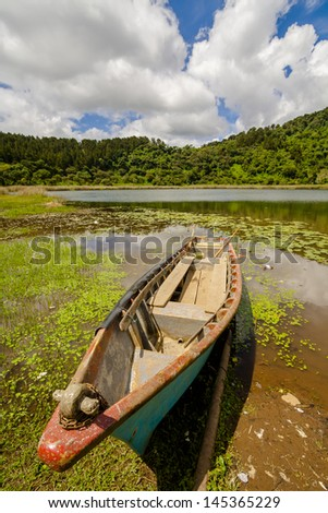 canoe in lake in el salvador, central america, nobody  - stock photo