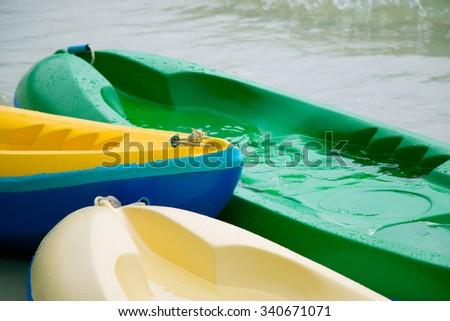 Canoe, kayaks land on the beach at beach of Toey Nham, Thailand. - stock photo