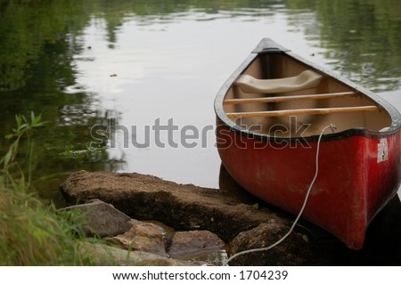 Canoe on a river in New Hampshire - stock photo
