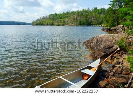 Canoe on Knife Lake in Quetico Provincial Park - stock photo