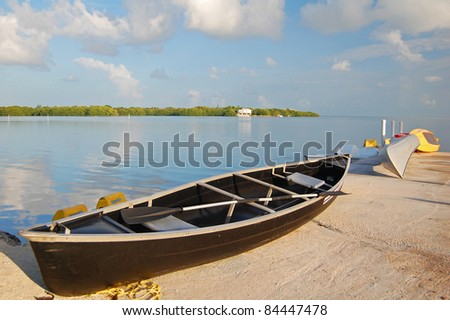 canoe on quay next to bay on the gulf of mexico