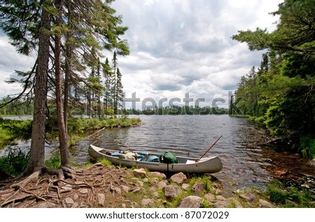Canoe ready to set off on Sitka Lake in the Boundary Waters - stock photo