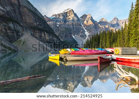 Canoeing at the moraine lake in banff canada  - stock photo