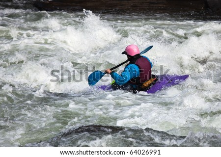 Canoeing in white water in rapids on river