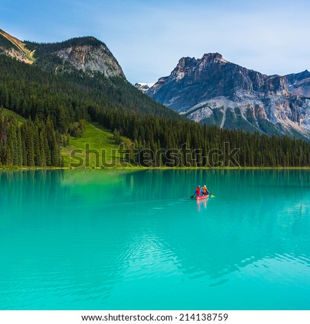 Canoeing on Emerald Lake in the rocky mountains canada  - stock photo