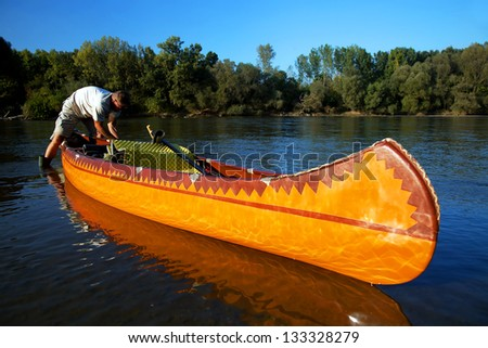 Canoeing on Mures River, Romania, Europe - stock photo