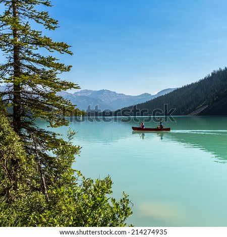 Canoeing on the Lake Louise in banff canada  - stock photo