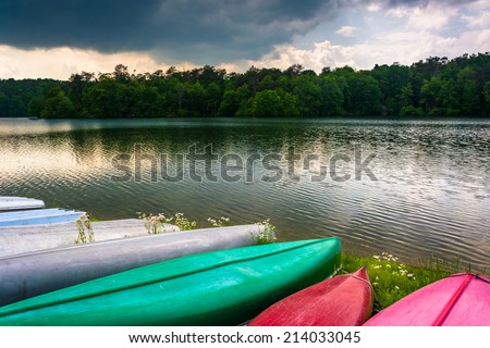 Canoes along the shore of Prettyboy Reservoir in Baltimore, Maryland. - stock photo