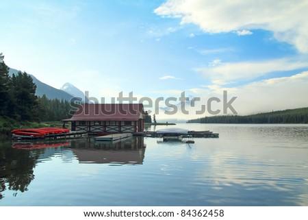 Canoes and Boathouse at Dawn - Maligne Lake, Jasper National Park, Alberta, Canada - stock photo